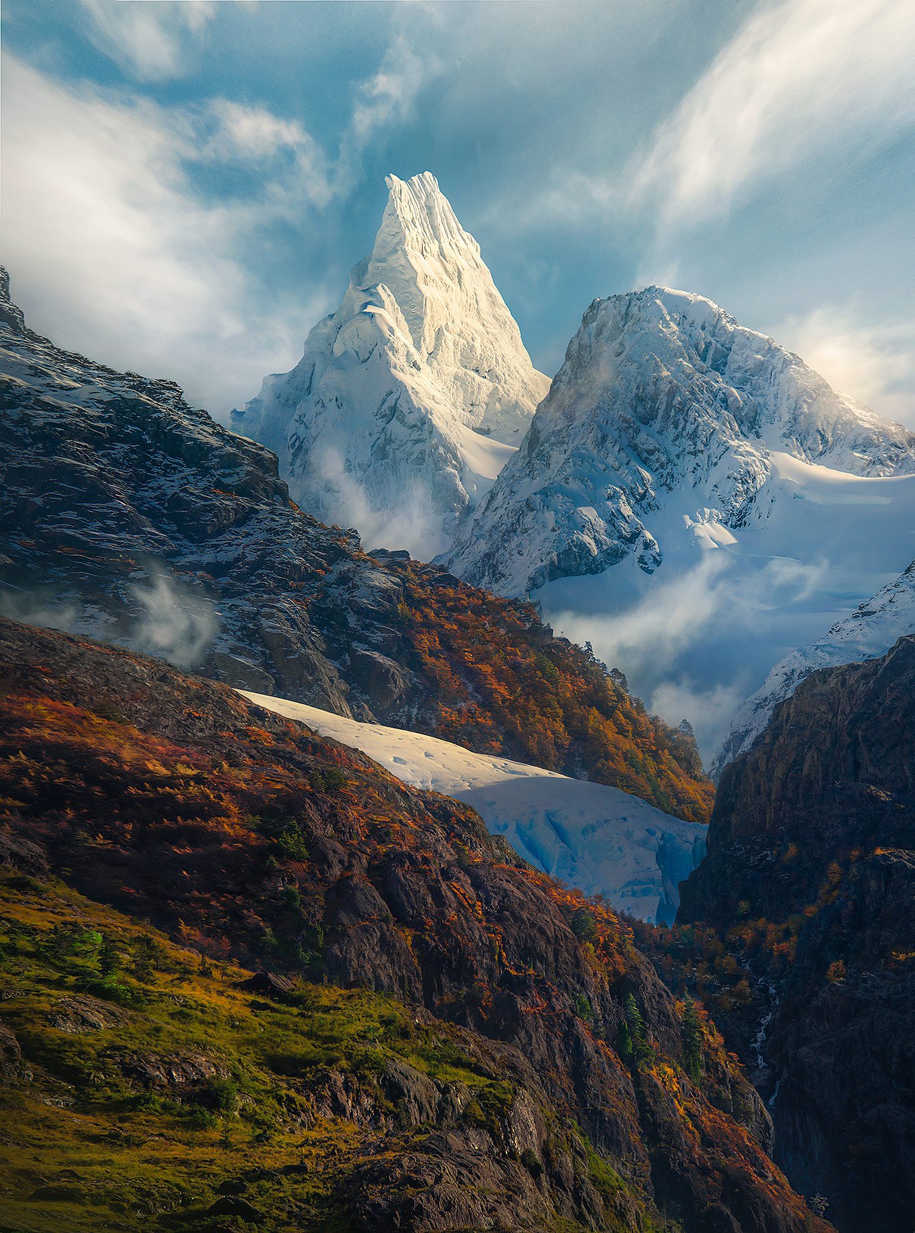 High peaks above the mountainous fiordlands of Chile in Autumn.
