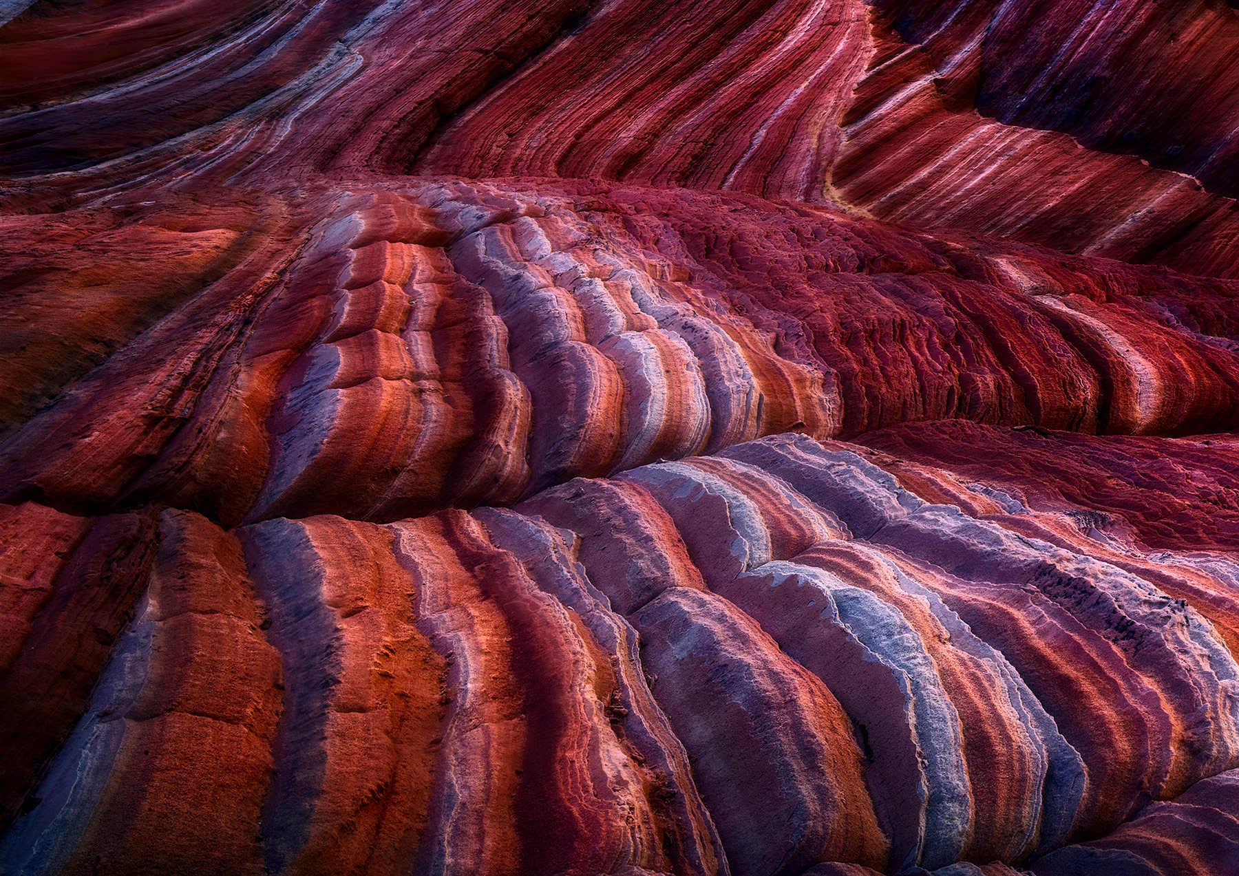 The highly textured curves of sandstone on the Colorado Plateau of Northern Arizona shown off by strong reflected light.