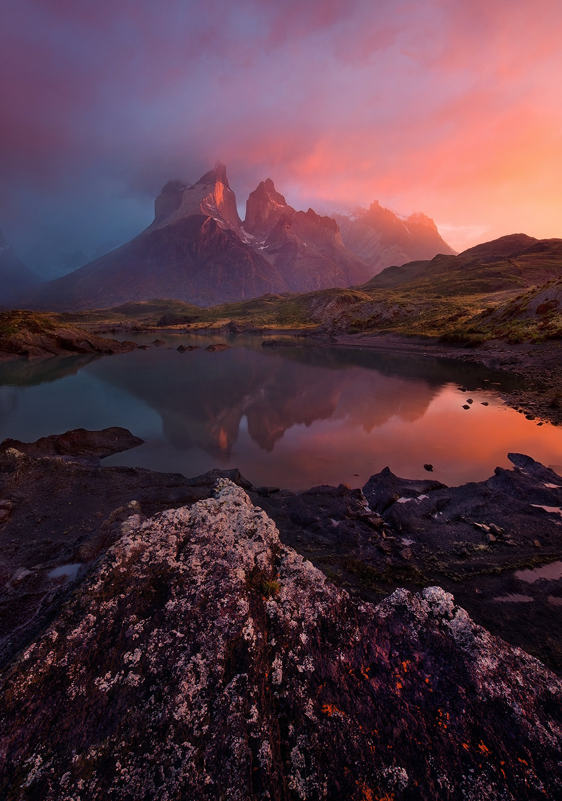 A clearing rainstorm at sunrise, reflections, Torres Del Paine and the light Patagonia is known for.