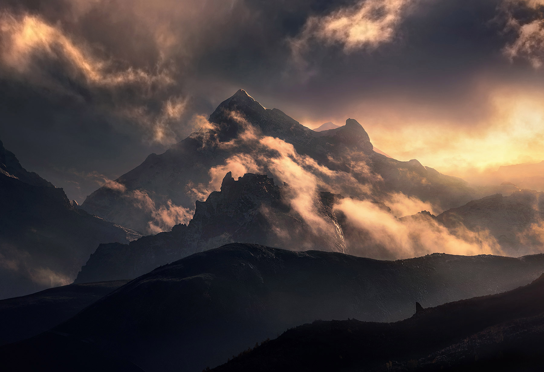 A long lens catches a dramatic perspective on these towering Himalayan giants, while the light brings them to life.