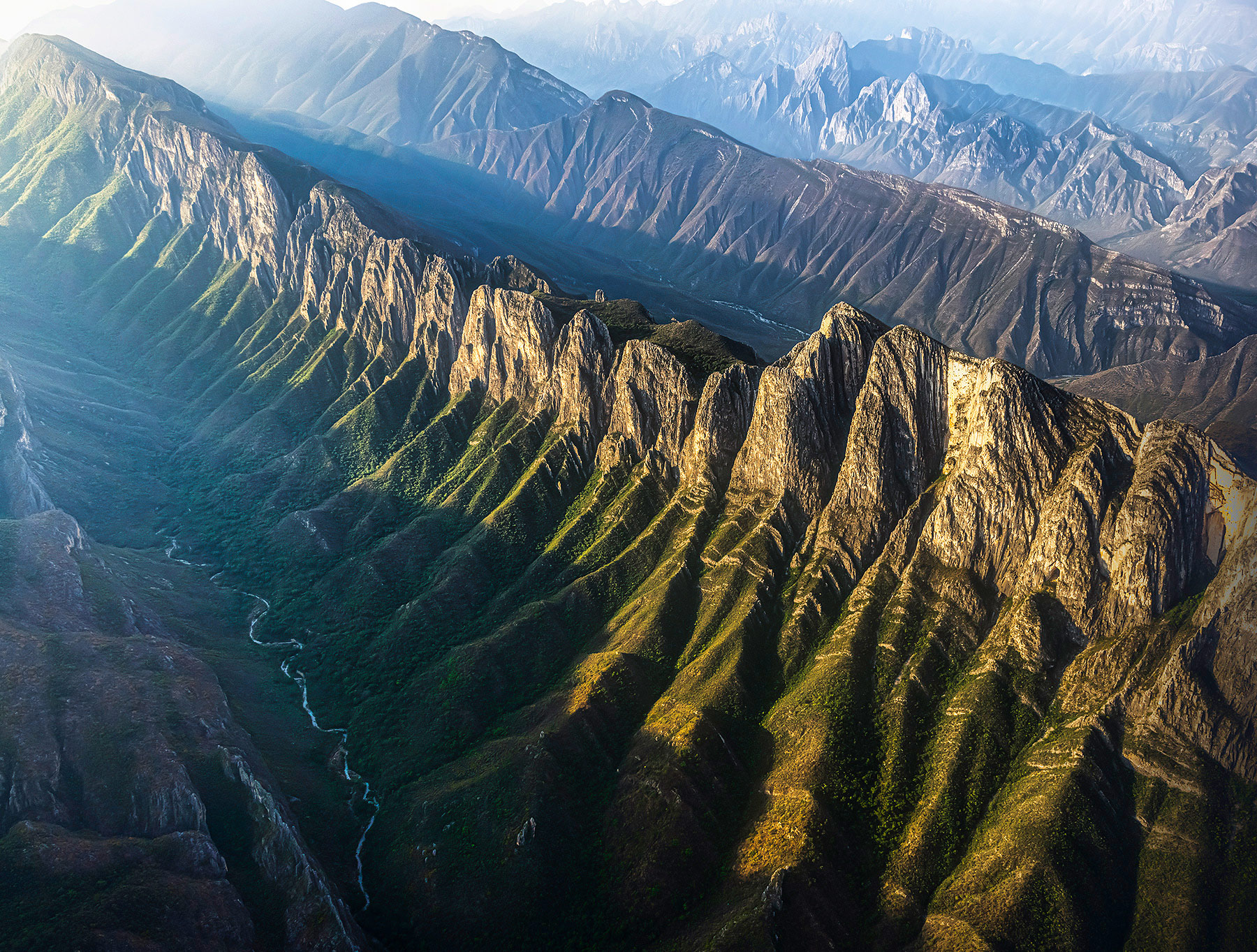 Layers of jagged cliff patterns and morning light above La Huasteca Canyons, Mexico