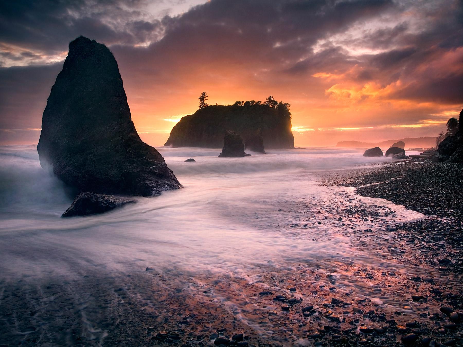Receeding waves amidst a vibrant sunset captured at Washington's famous Ruby Beach.