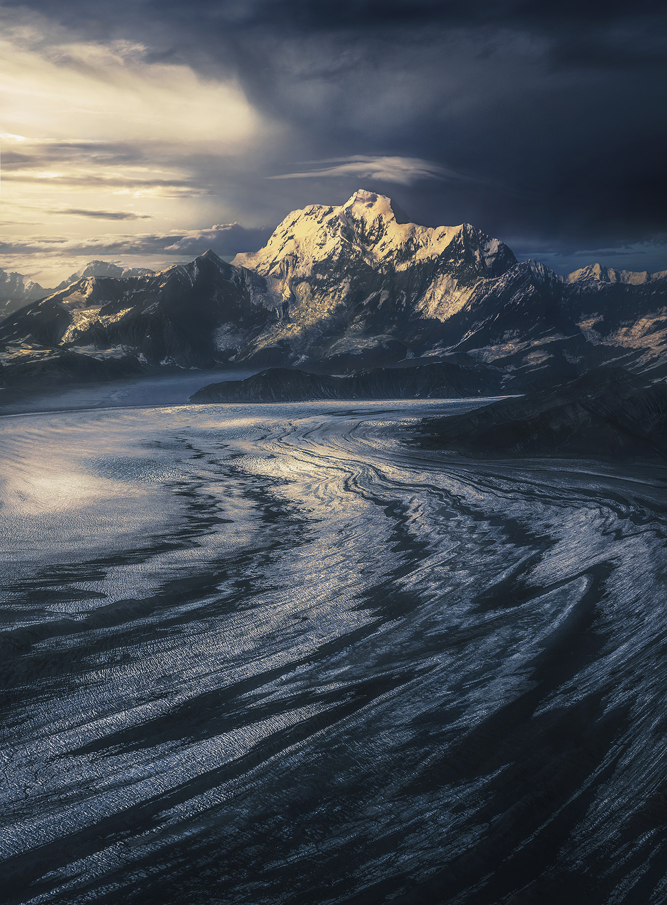 The great Mount St Eliascatches the light, towering more than fifteen thousand feet higher thanglaciers you see below...