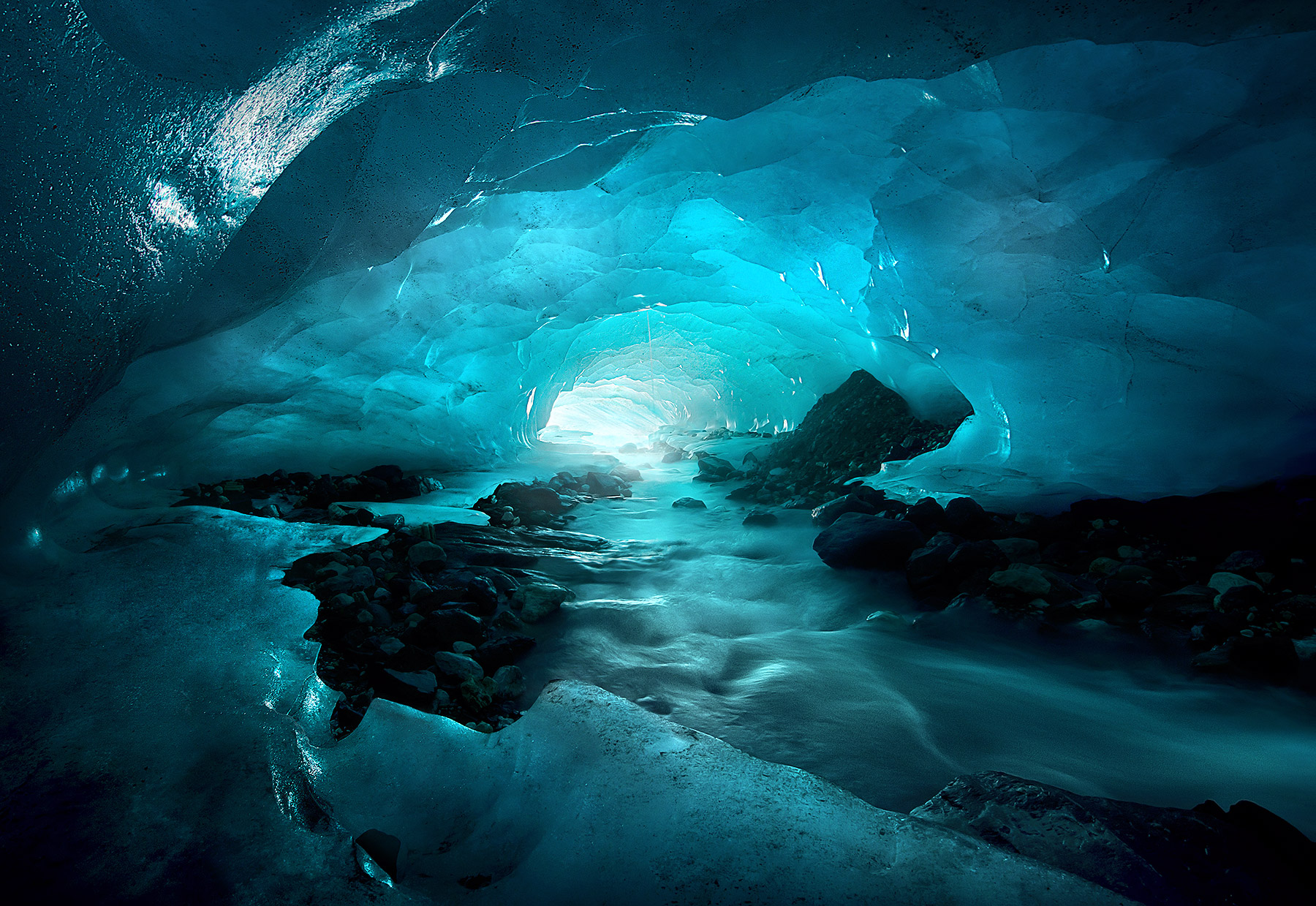 A photograph from inside the amazing world of ice caves, tunnels and other sub-glacial passages I found while trekking across...