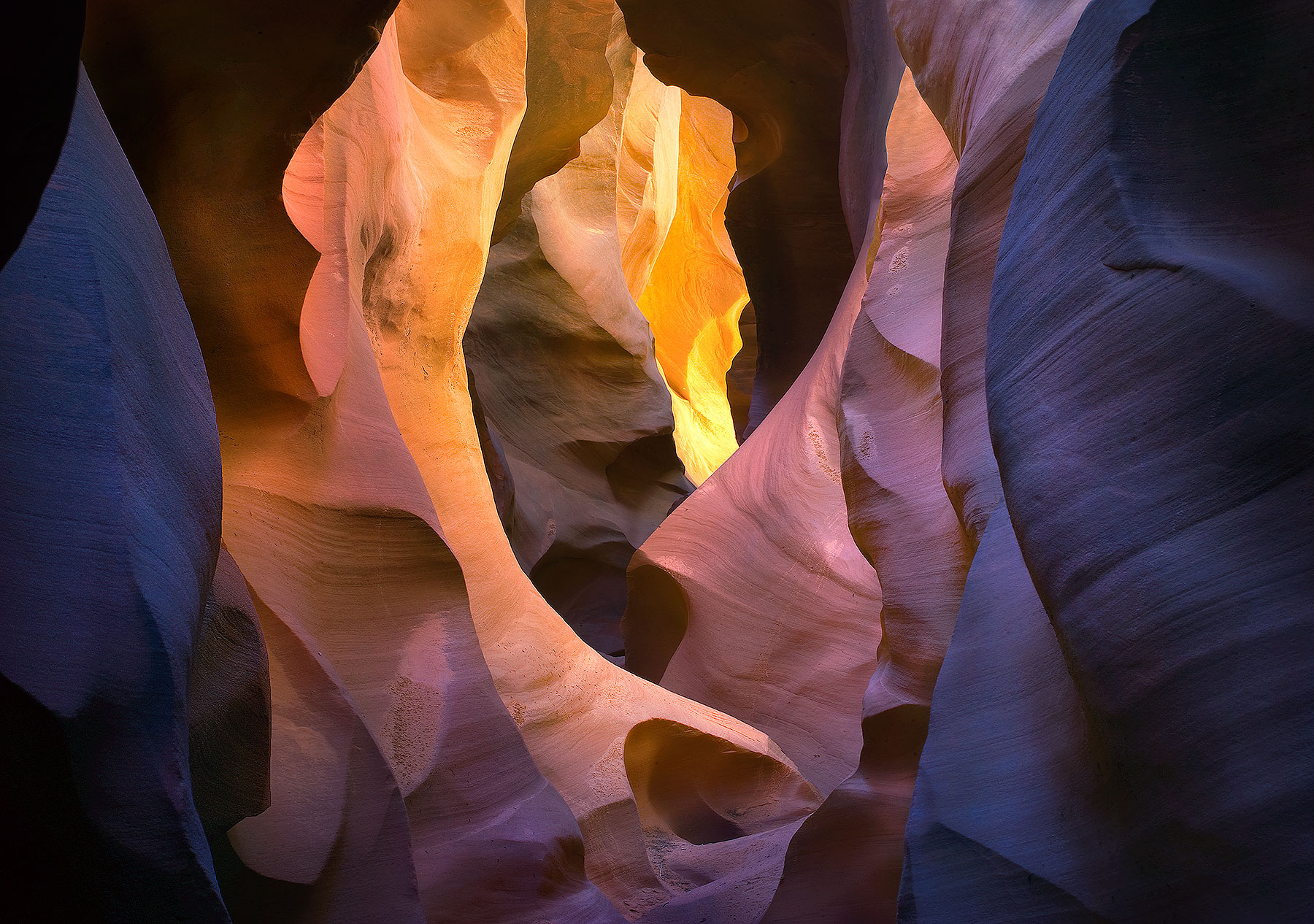 An incredible display of light, color and textures found in this remote sandstone slot canyon. The various rich colors and hues...