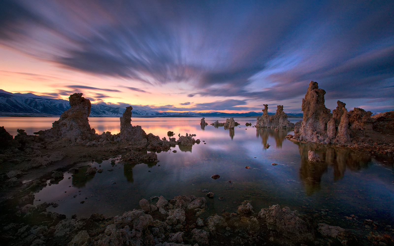 California's Mono Lake photographed at twilight. A long exposure creates the streaks of clouds and smooth water effect you see...