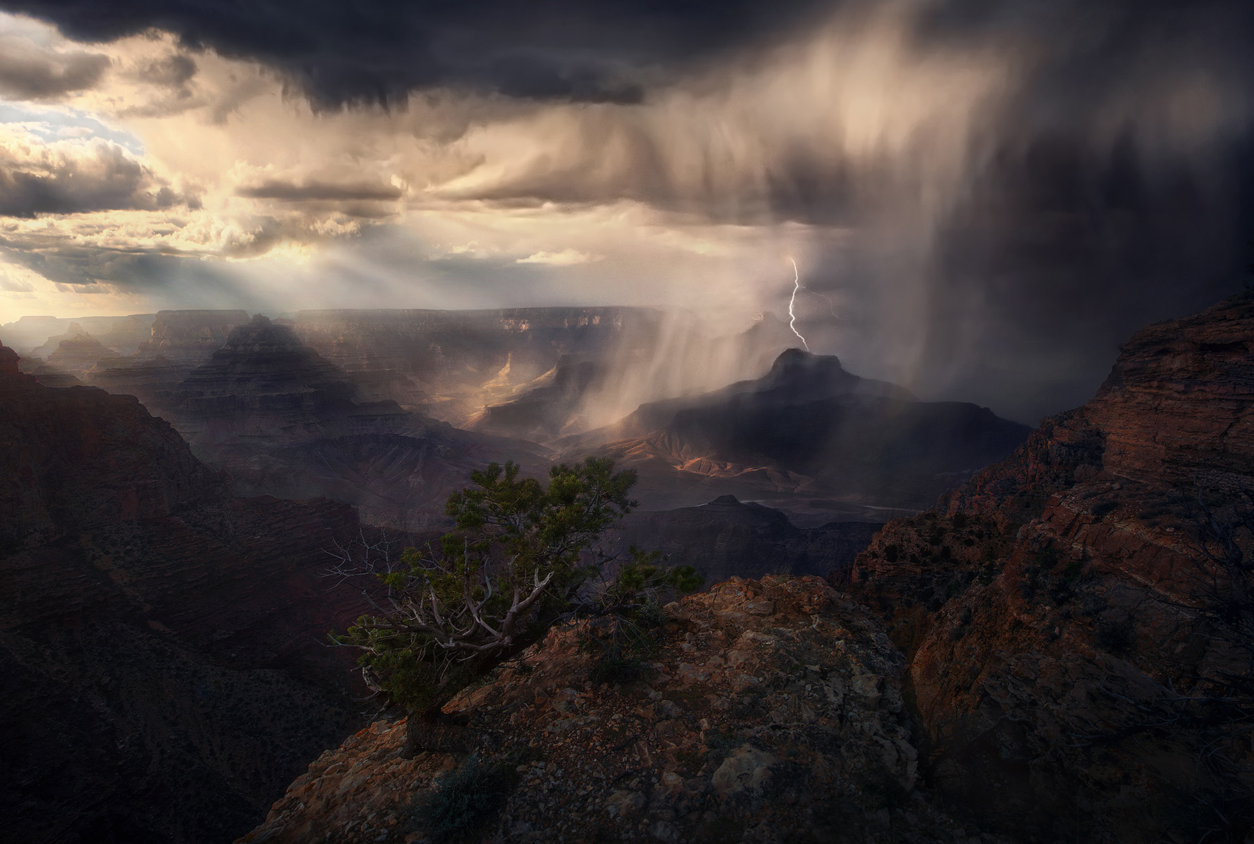 A monsoonal storm envelopes the great layers of the Grand Canyon in Arizona