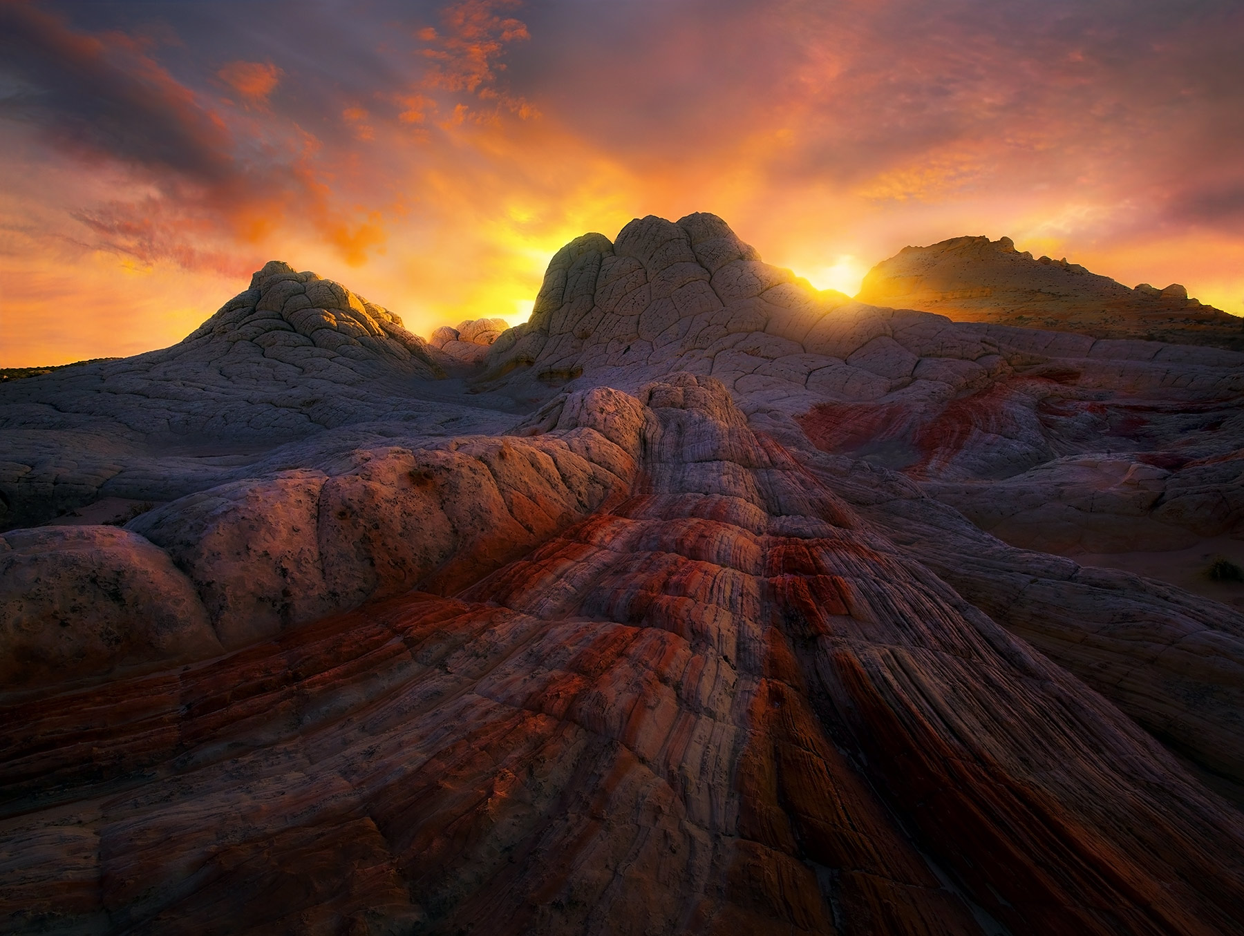 The otherworldly sandstone formations of Arizona's Colorado Plateau region on display in this dramatic sunset light.