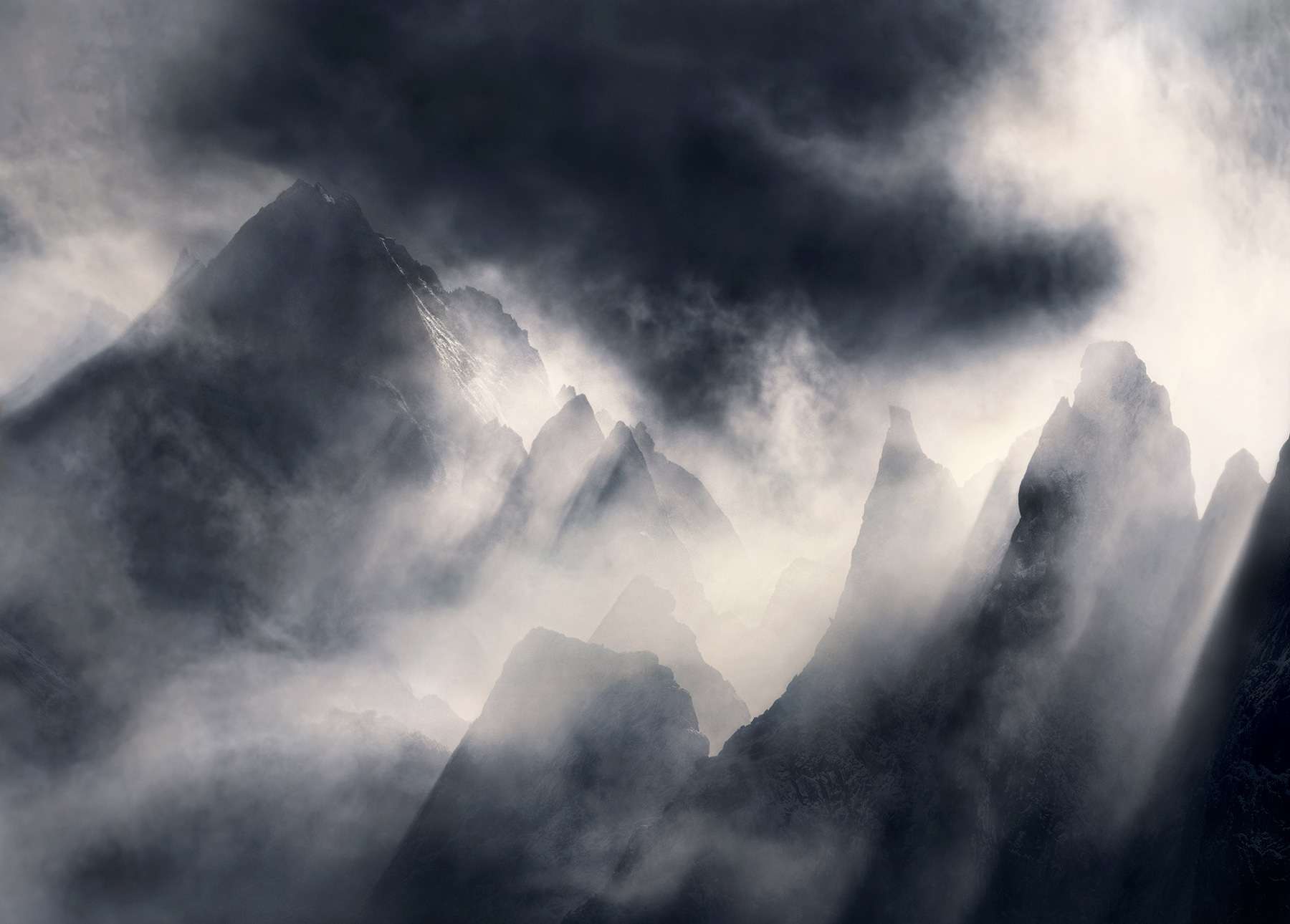 Jagged peaks catch the layers of light coming through the clearing storm.