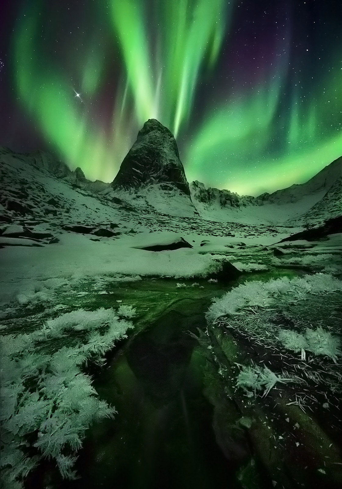 An amazing show of Aurora over peaks in the Yukon's Ogilvie Range. An extreme-high ISO was used combined with depth of field...