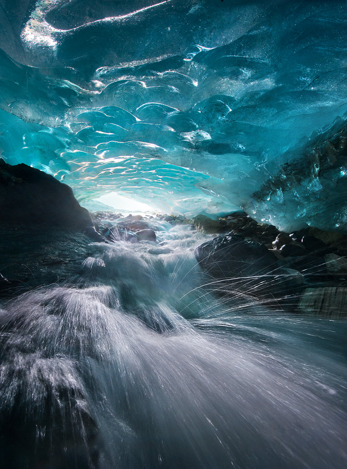 One of the raging-fast, cold and wet passageways I photographed while climbing through an extensive network of glacial blue-ice...