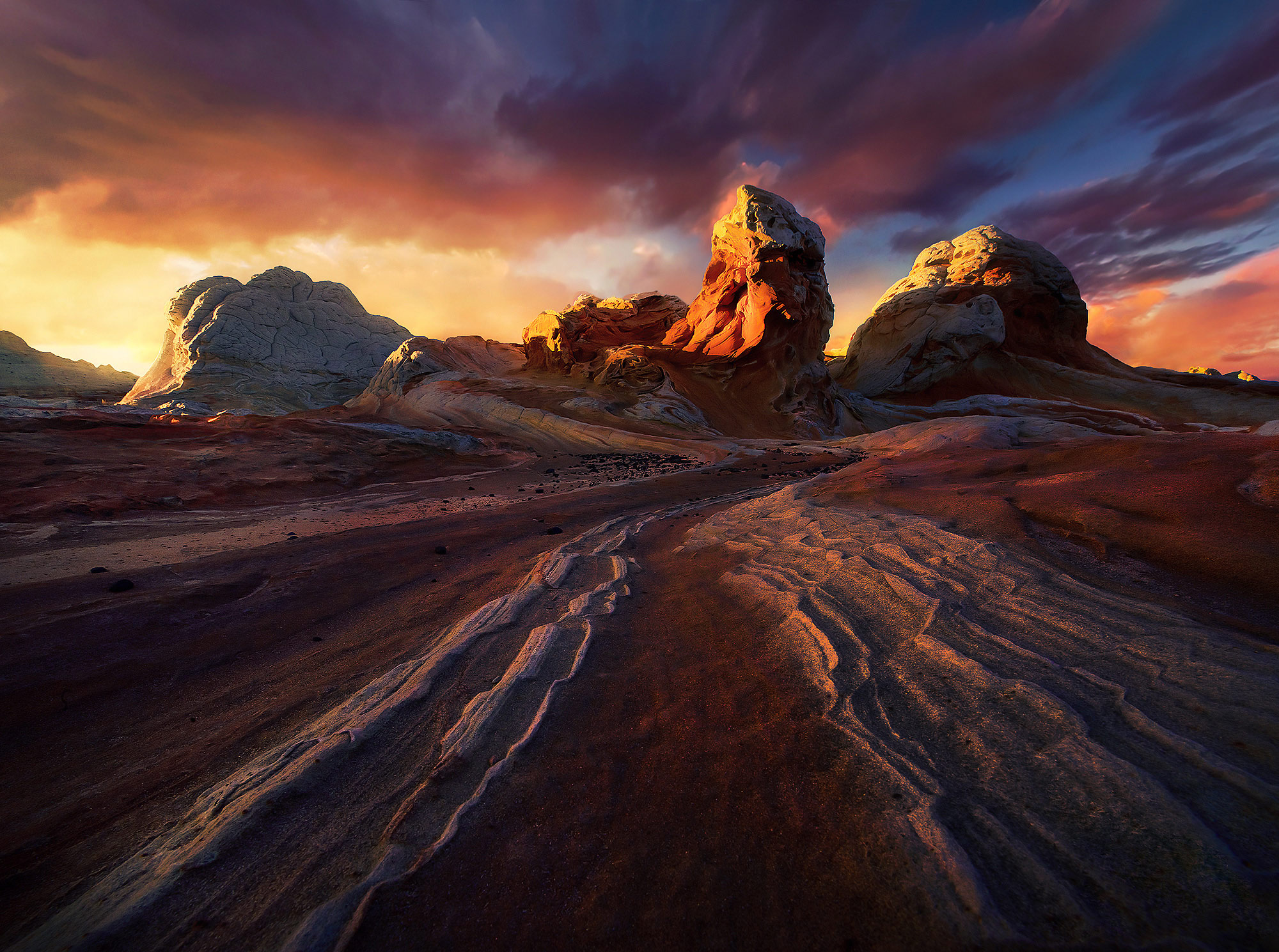 Explosive sunset light and dark, dramatic skies over sandstone formations in Arizona.