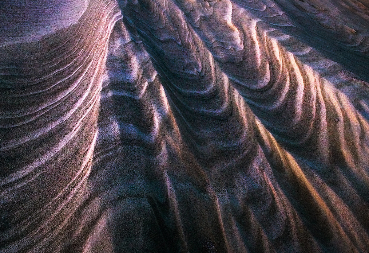 Wet sand creates a rock-like appearance tothese sandy textures, temporarily preserving them as they dry and eventually...