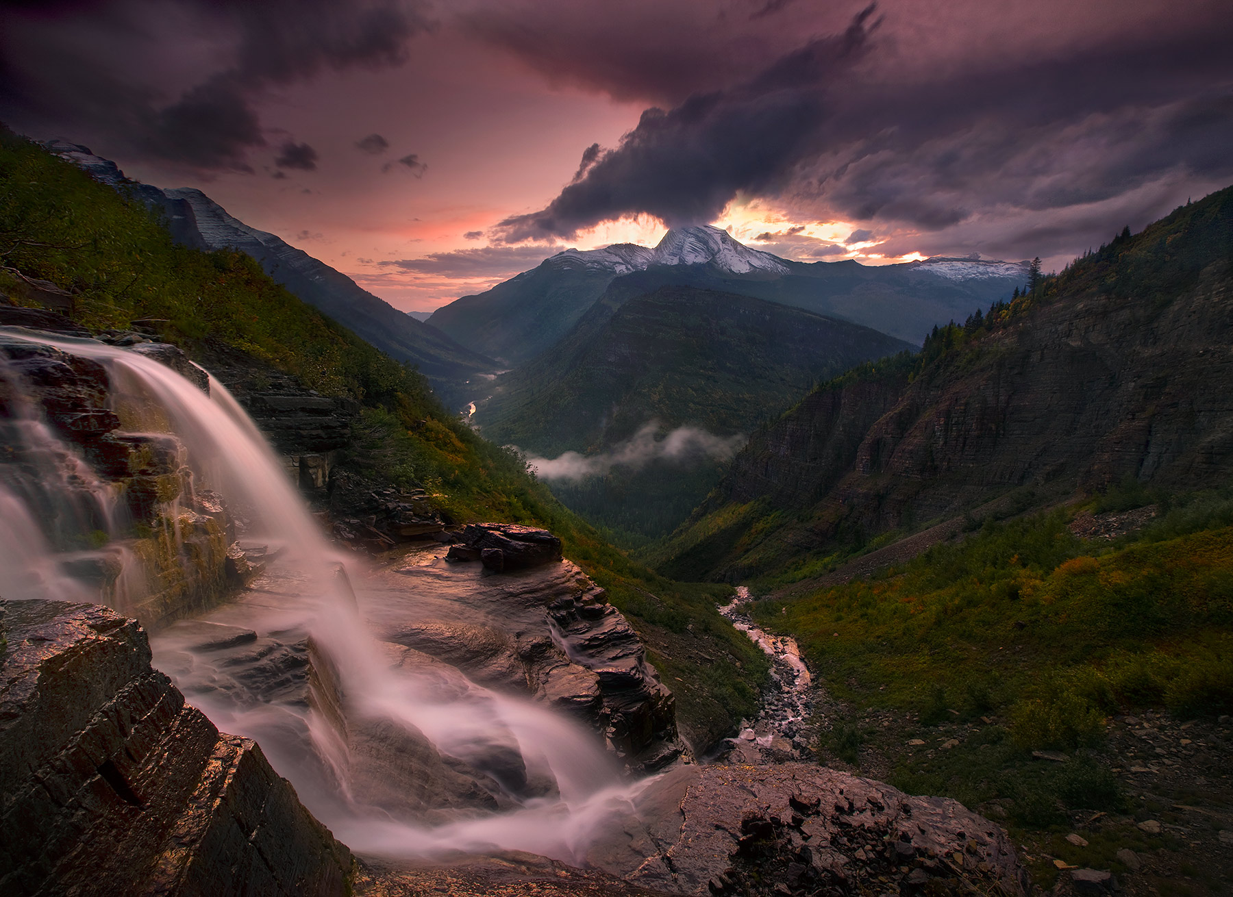 Dark, dramatic and amazing views at twilight I captured while perched on the side of a cliff just off Glacier's famous Going-...