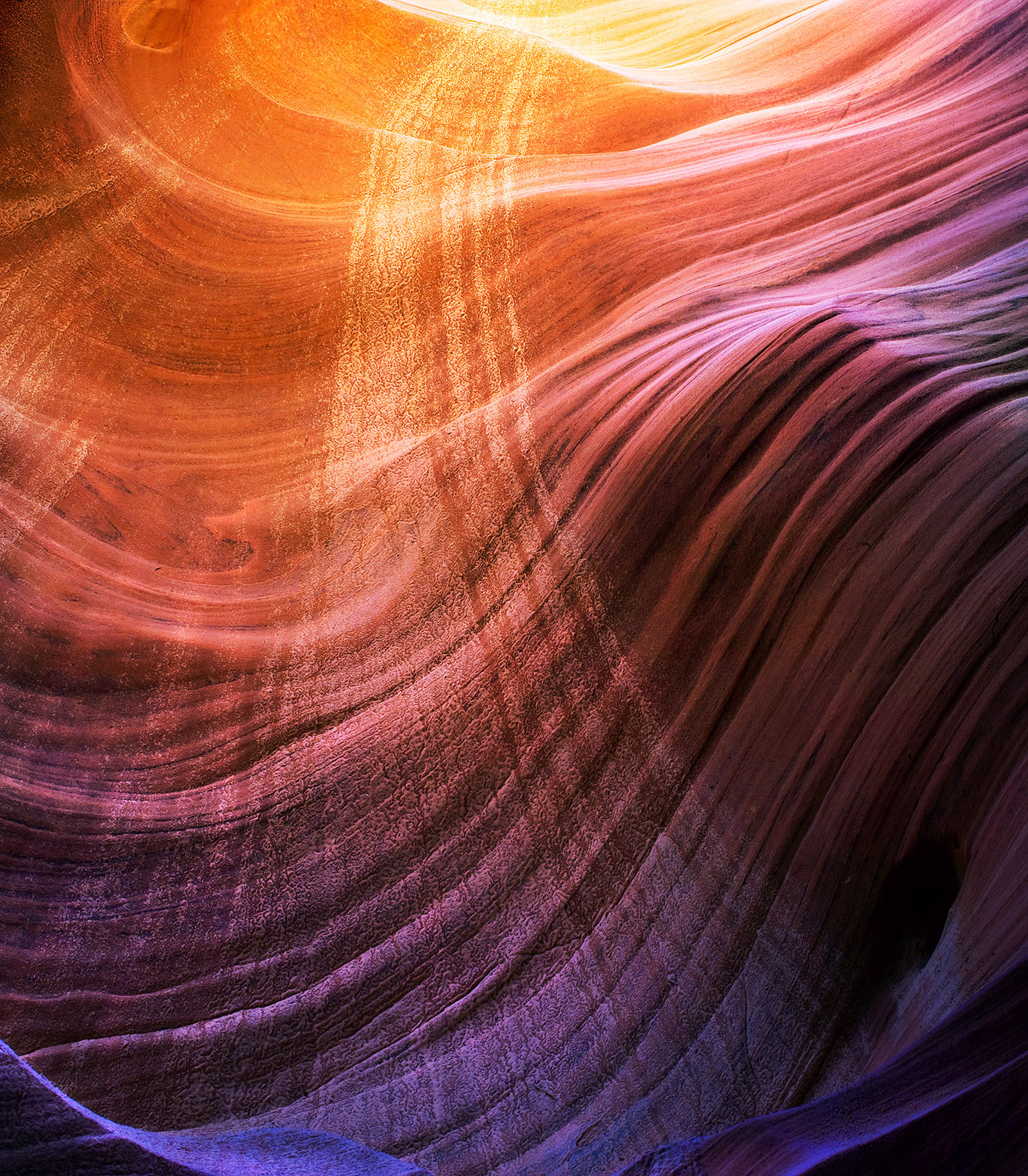 The curvature of sandstone waves deep inside a remote slot canyon are complimented by the opposite lines left behind by an occasional...