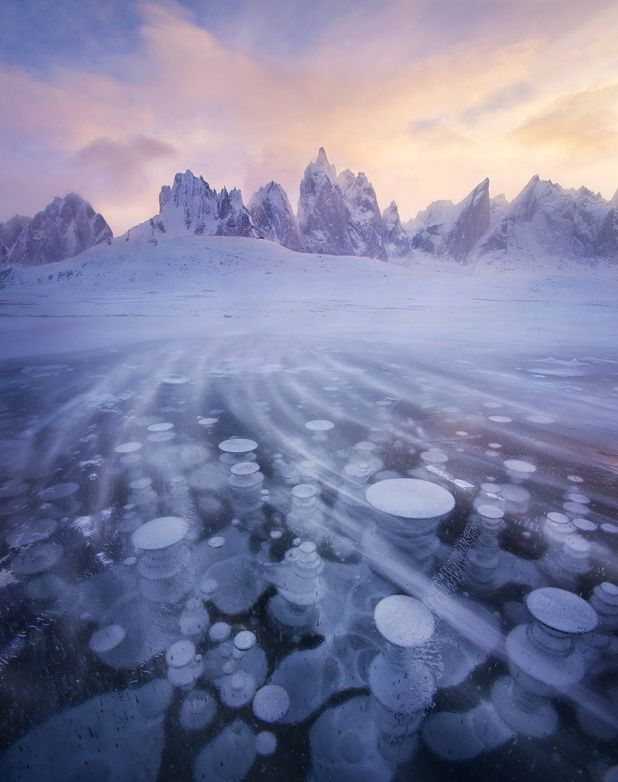 The brutal cold of winter arrives on the wind across this frozen lake in the Yukon's north, captured at the end of a 16-day backpacking...