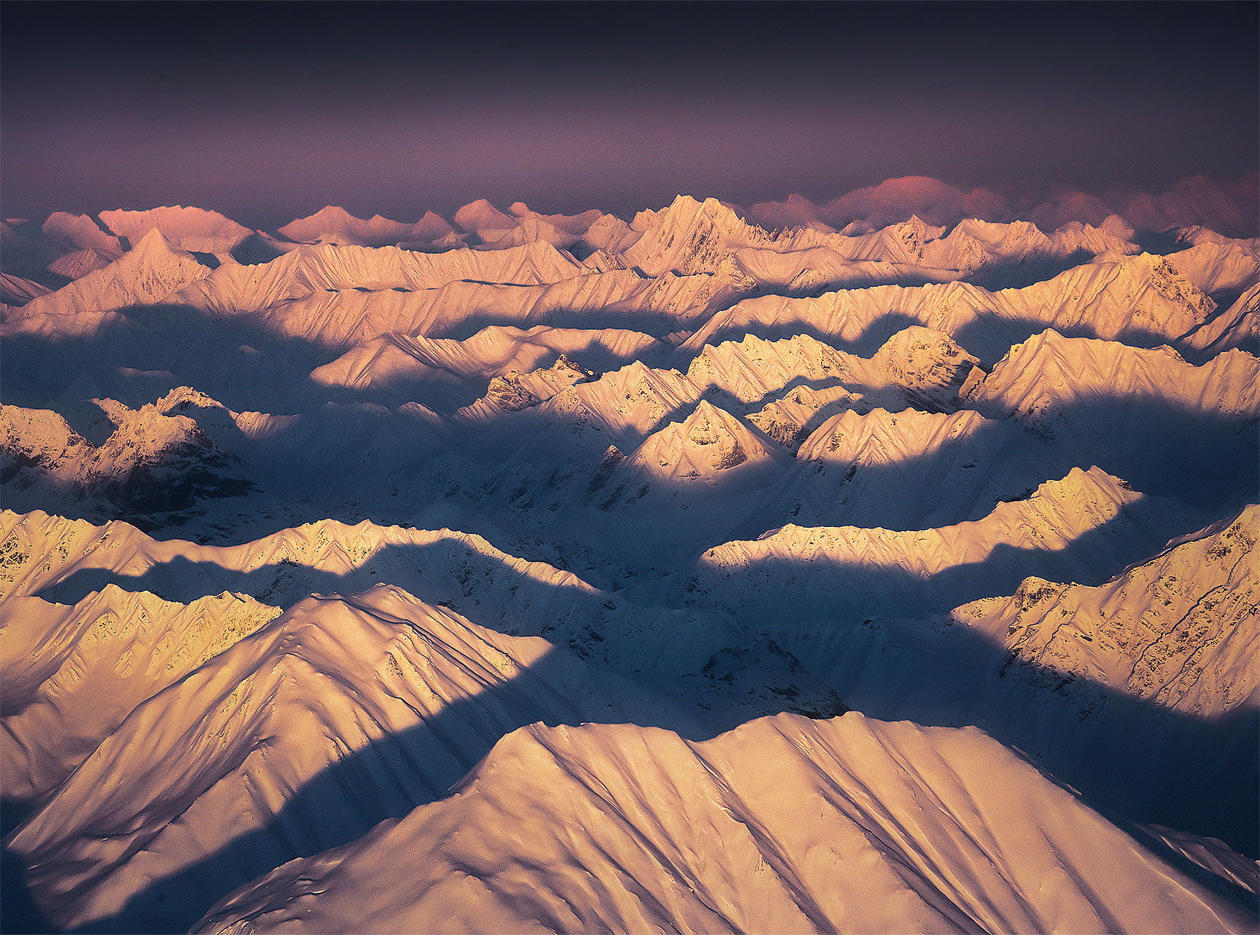 Endless layers of mountains at sunset from a bush plane over Denali National Park, Alaska