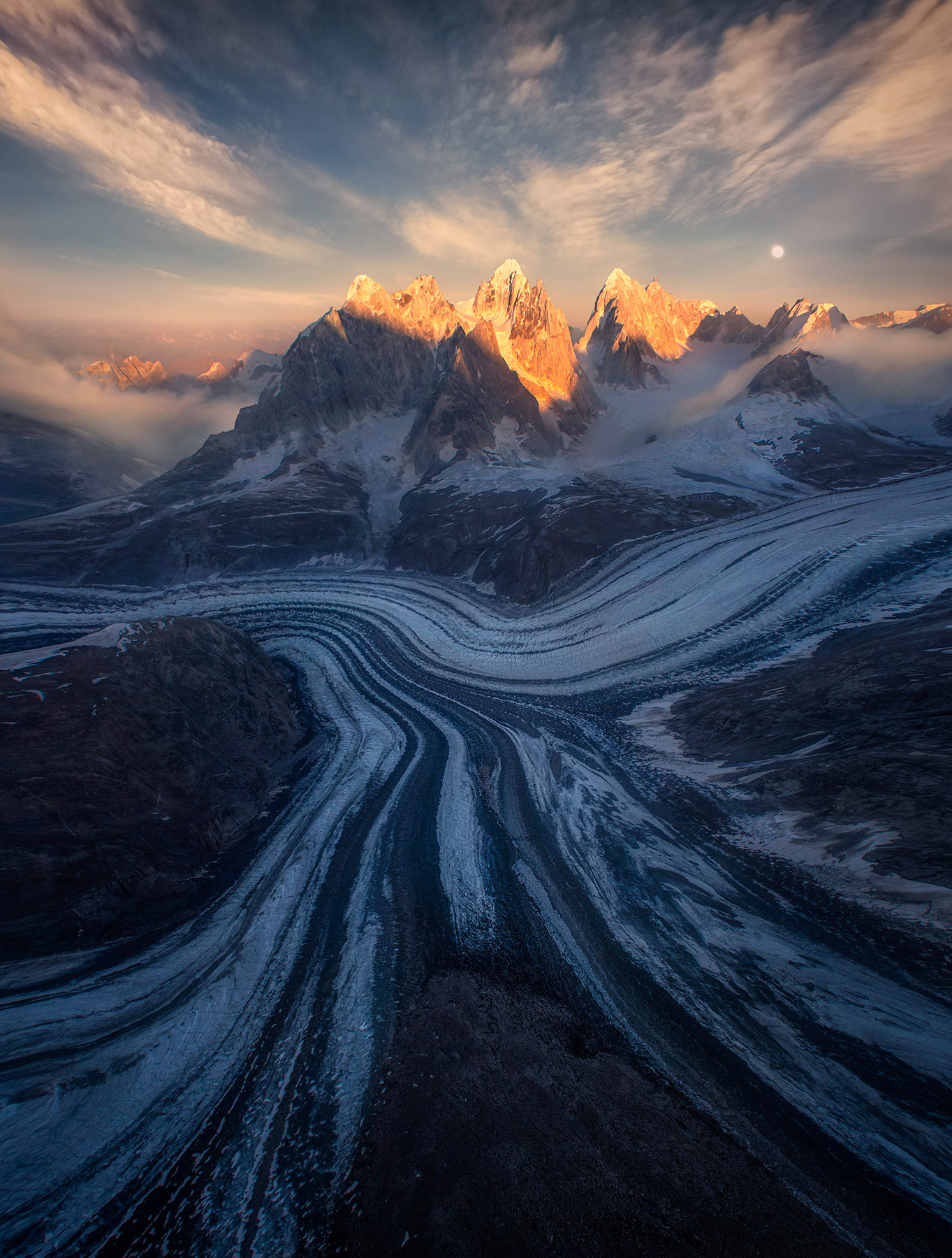 Foreboding towers above glaciers at sunset deep in the north side of the Fairweather range, Alaska.