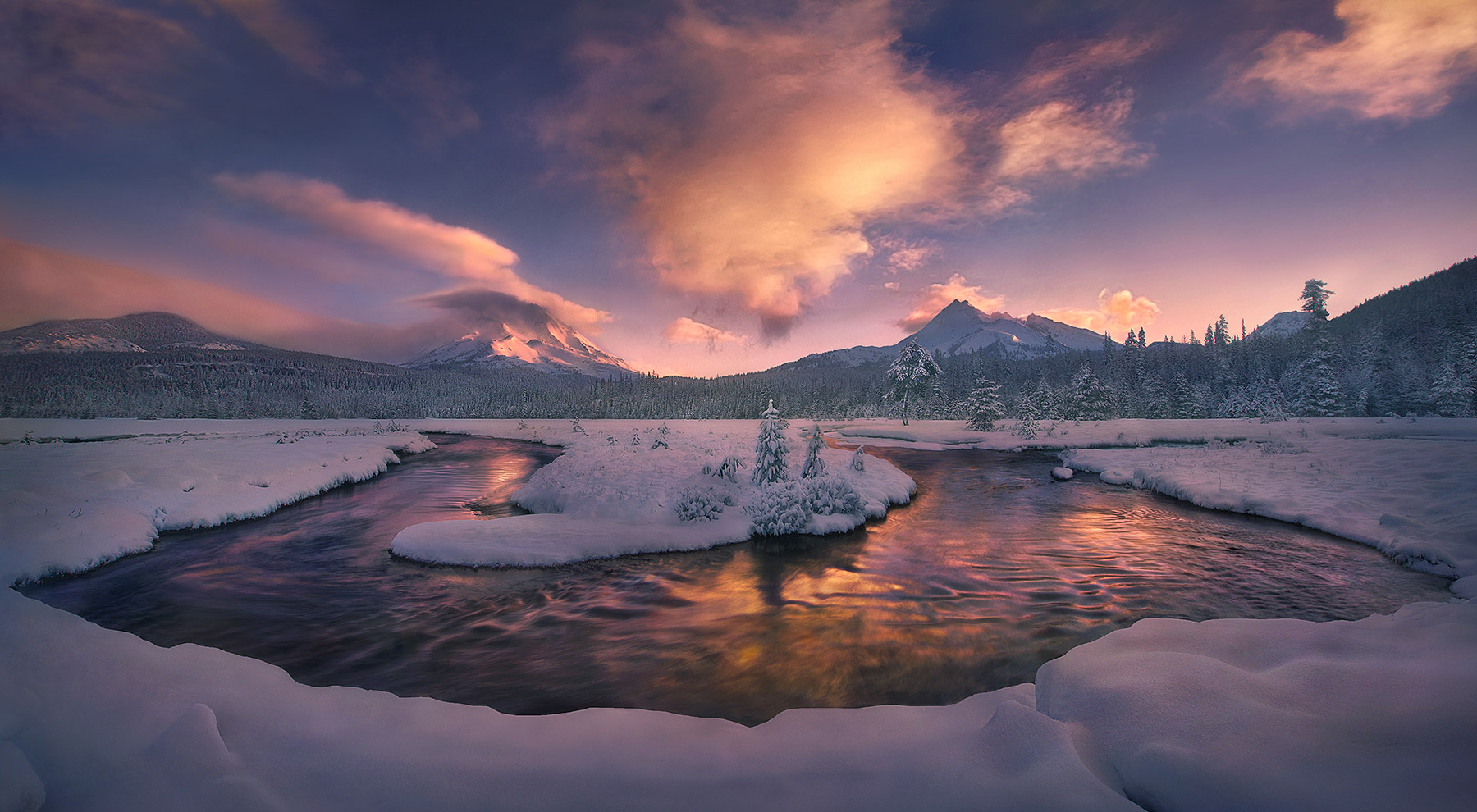 New snowfall adorns the landscape within Oregon's Three Sisters Wilderness, looking towards South Sister and Broken Top peak...