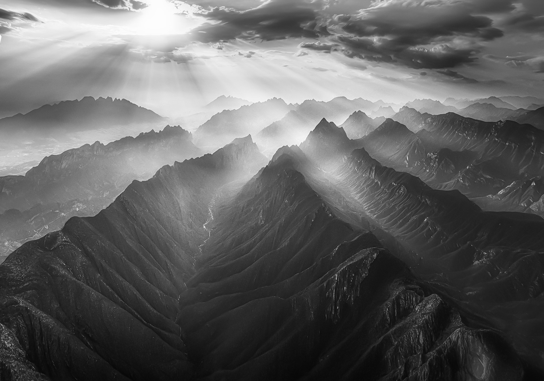 Jagged ridge lines viewed from the air over La Huasteca Canyons, Mexico