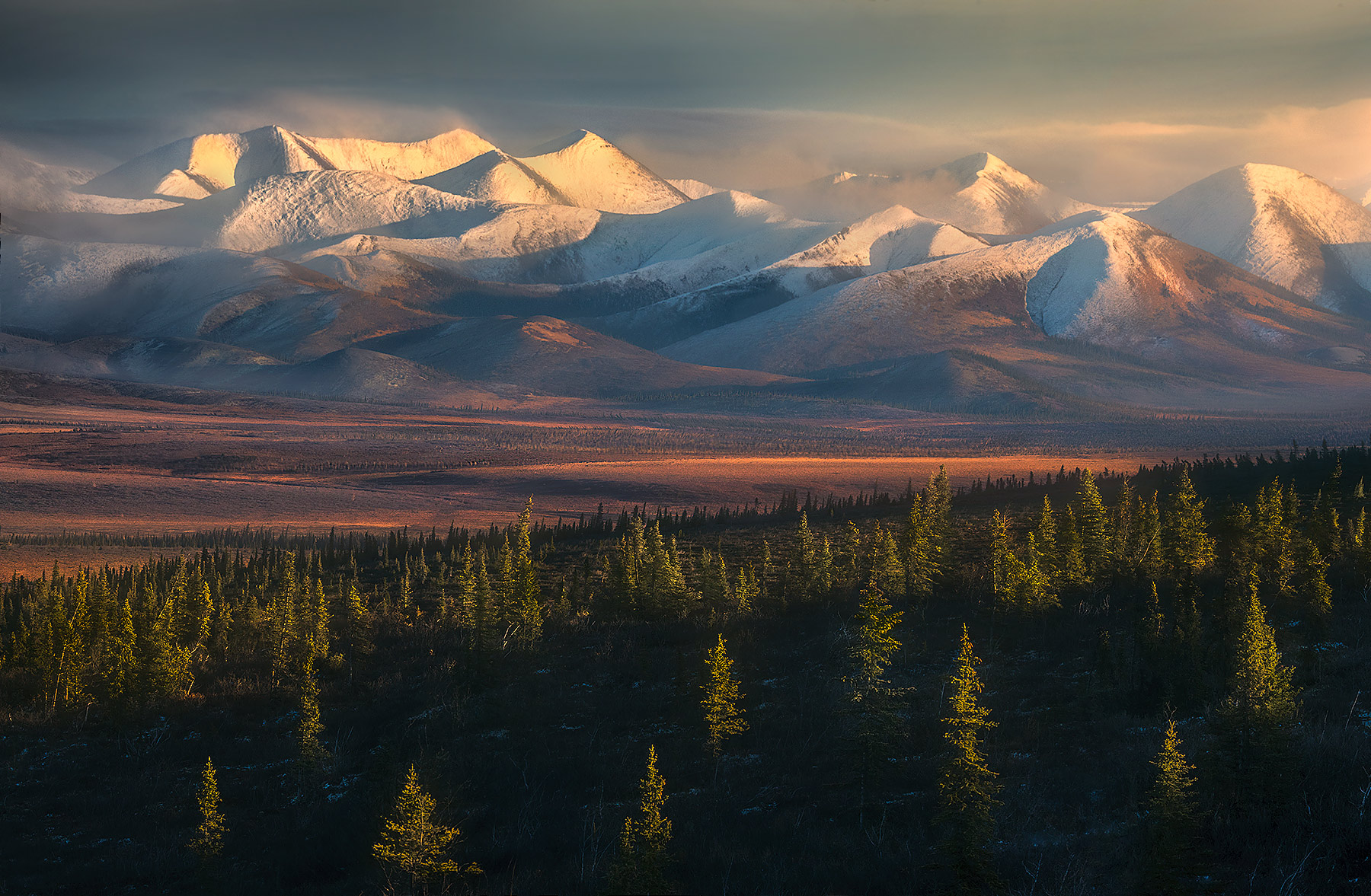 The Richardson Range lies in the Far North of Canada's Yukon, above the Arctic Circle.  Here, soft light fades through high clouds...