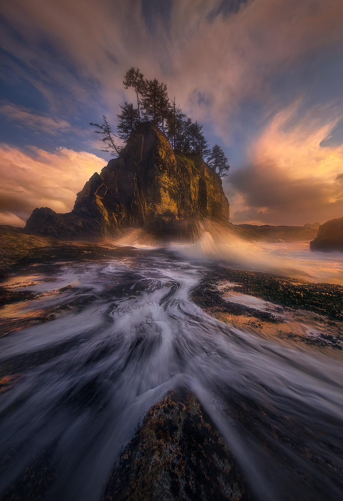 A unique perspective on the towering sea islands of the Olympic Coast in Washington featuring tremendous combination of wave...