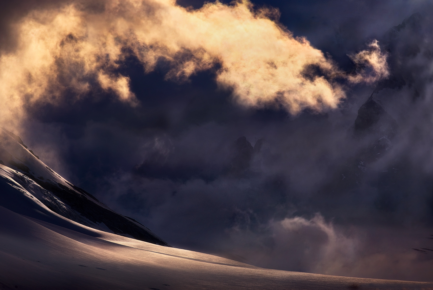 Light in the Pacific Range, British Columbia. Look closely at the releif of the background peaks through the clouds. &nbsp...