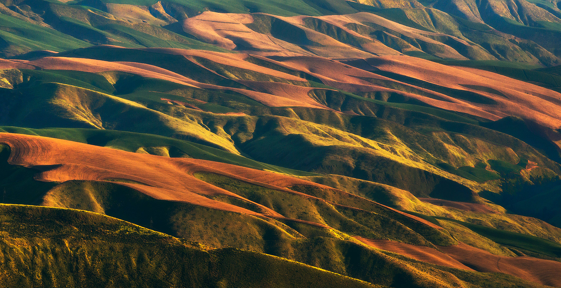 Layers of farmland photographed with a 400mm telephoto in Washington's Columbia River Gorge.