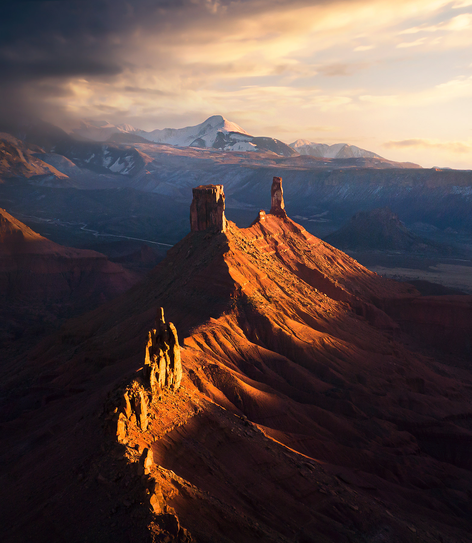 Red Rock towers adorn the Utah landscape as the snowy La Salle Range clears at sunset
