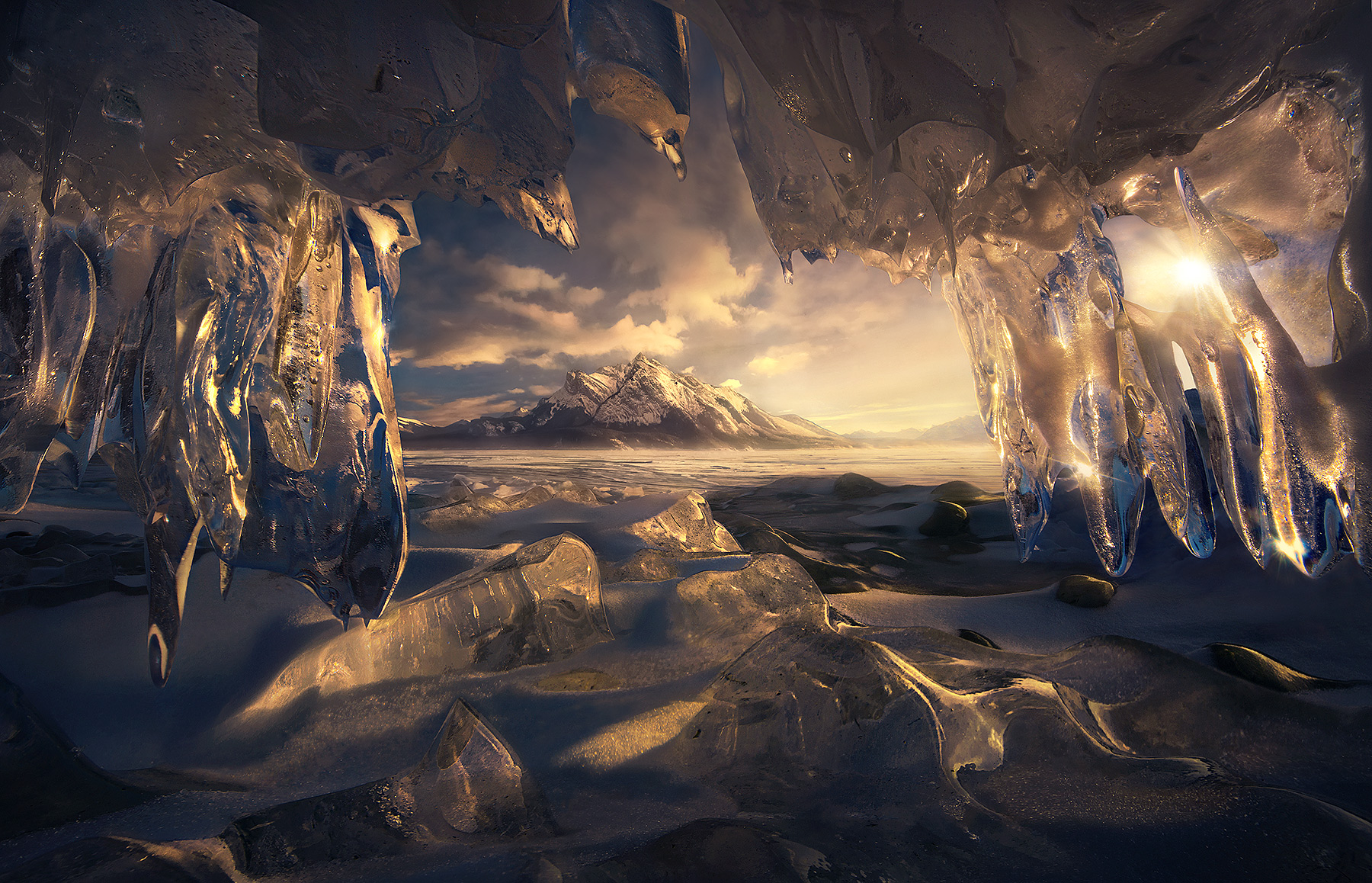Inside an incredible, sparkling, really really small ice cave looking out.
