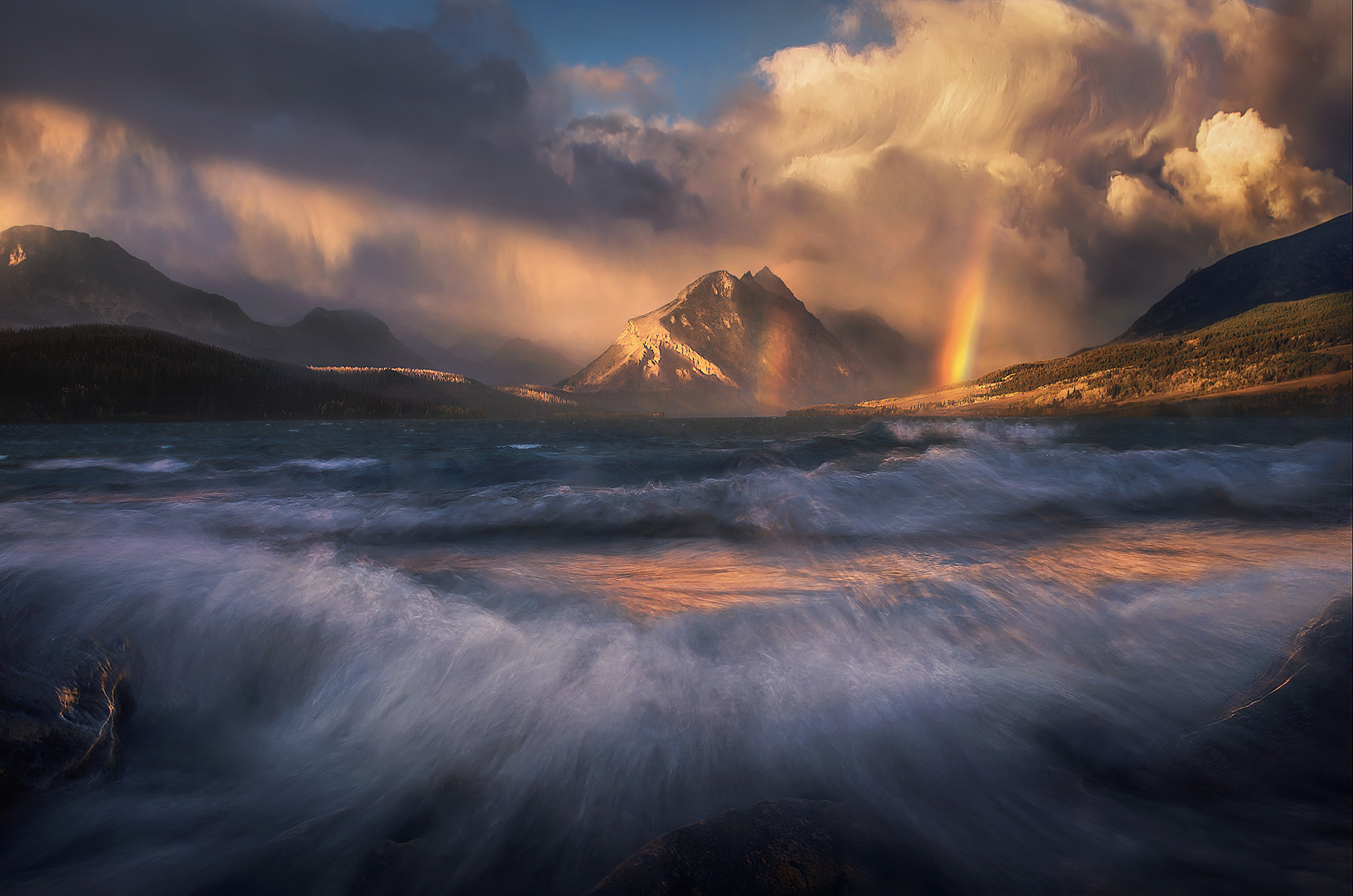 Roaring waves as the storm closes on St. Mary Lake in Glacier National Park creating some amazing light.