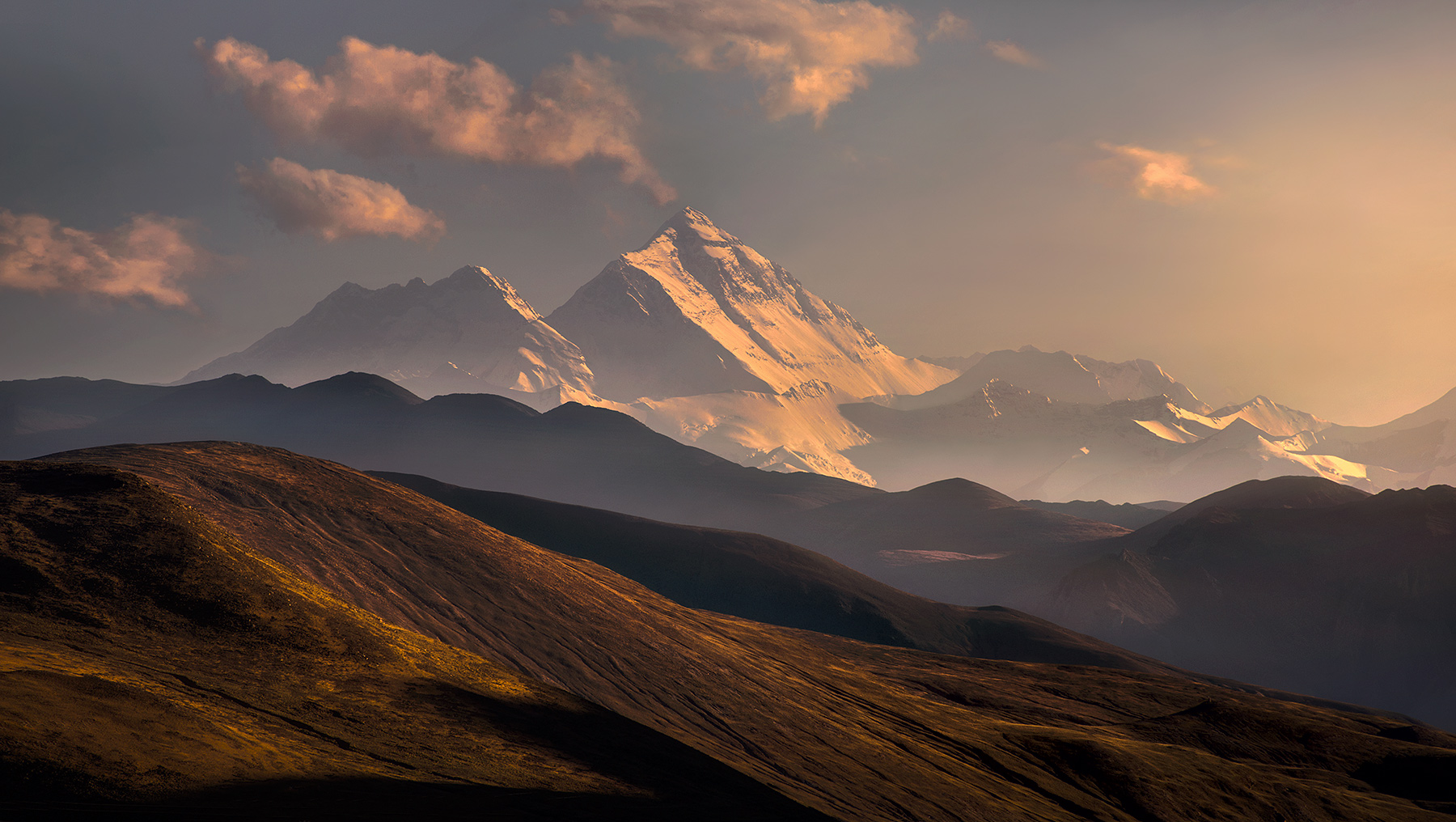 Mount Everest rises above the layers of Tibetan plains.