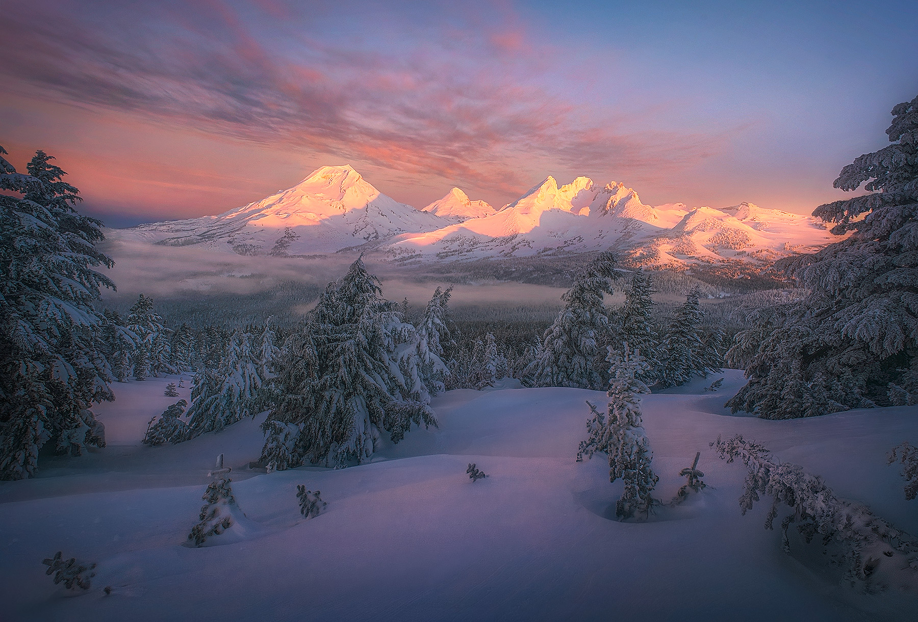 A beautiful winter morning dawns over the snowy Three Sisters wilderness in central Oregon